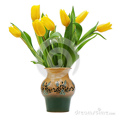 Flower bouquet from yellow tulips in vase isolated on white back