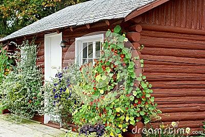 Flower Covered Log Cabin