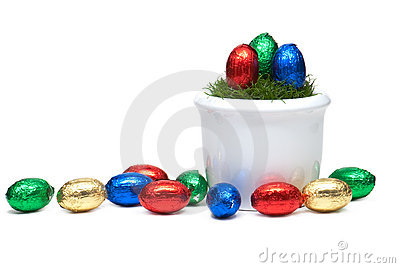 Flower pot with Easter eggs and grass