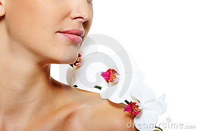 Flower on shoulder of the woman with clean skin
