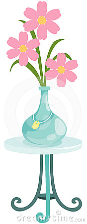 flower in vase on glass table