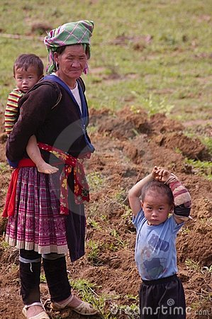 Flowered Hmong grandmother and her grand children Editorial Stock Photo