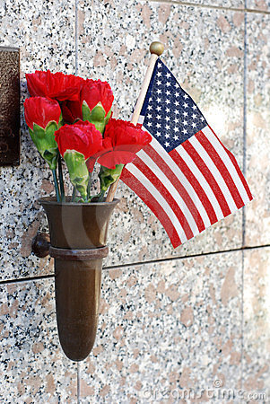 Flowers and American Flag at crypt