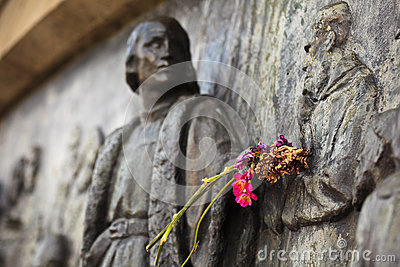 Flowers on arm of Christopher Columbus Monument