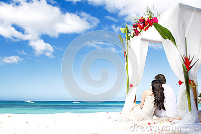 With flowers on beach