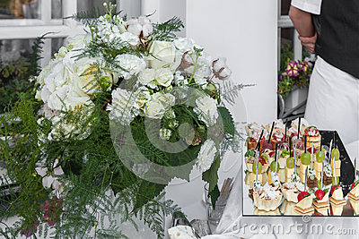 Flowers bouquet and tray canapes