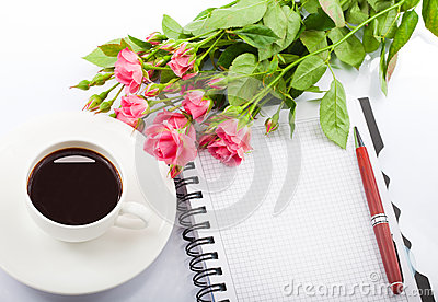 Flowers, coffee and notebook.