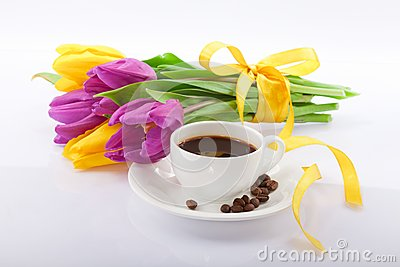 Flowers and a cup of coffee.