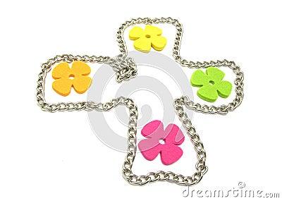 Flowers of felt in a metal cross
