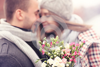 Flowers and kissing couple in the background