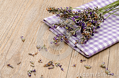 Flowers of lavender on a cloth and wood