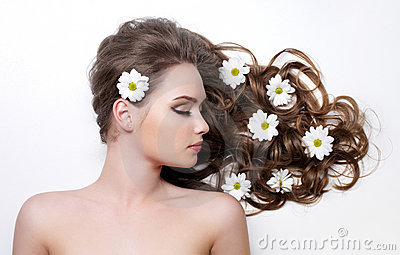 Flowers in long hair of teen girl
