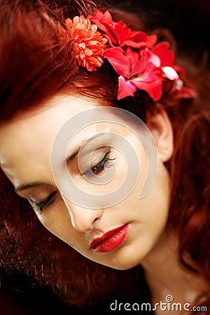 Flowers in striking red hair