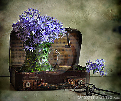 Flowers and suitcase