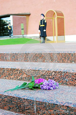 Flowers by the Unknown soldier tomb in Moscow Editorial Photo