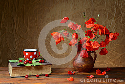 Flowers in a vase with a book