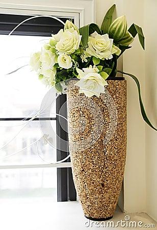 Flowers beside window