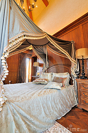 Flowery curtain of bed in classical bedroom
