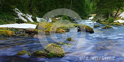 Flowing blue water of river Stock Photo