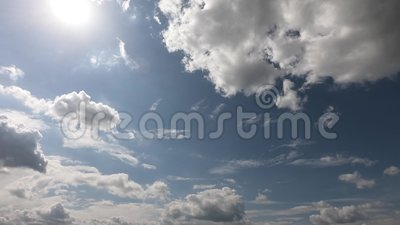 Small and fluffy cumulus cloud in the clean blue sky. stock video footage