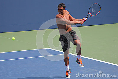 Professional tennis player Janko Tipsarevic practices for US Open at Billie Jean King National Tennis Center Editorial Stock Photo