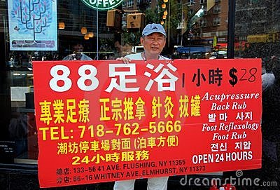 Flushing, NY: Man with Advertising Sign Editorial Stock Image