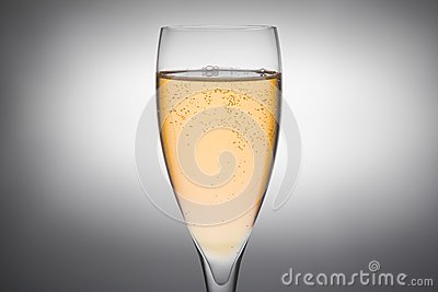 Flute of champagne with gold bubbles
