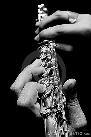 Flute in hands - music concept