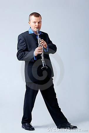 Flutist is Playing on Flute.