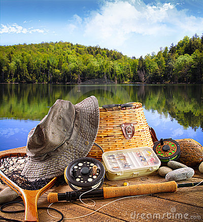 Fishing Supplies on Fly Fishing Equipment Near A Lake Royalty Free Stock Photography