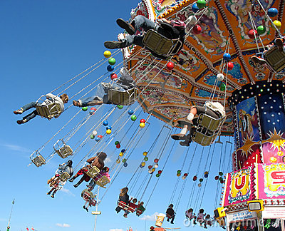 Fly in the sky - small colourful carousel. Editorial Photography