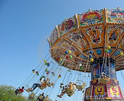 Fly in the sky - small colourful carousel Editorial Photo