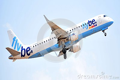 Flybe airlines power enginees in elevation maniobre to flight Editorial Stock Image