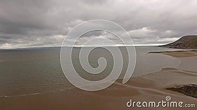Flyga över stranden av Llandudno, Wales - Förenade kungariket arkivfilmer