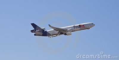 Flygplan uttryckta Federal Express Redaktionell Arkivfoto