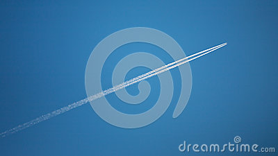 Flying airplane with contrails