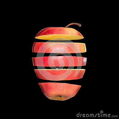 Free Flying Apple. Sliced Red Apple Isolated On Black Background. Levity Fruit Floating In The Air. Stock Image - 93979421