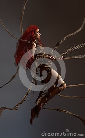Free Flying Beautiful Red Haired Woman Bounding By Ropes Stock Image - 105406381