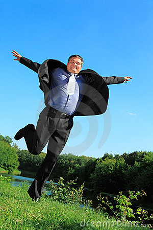 Flying businessman outdoor in summer full body