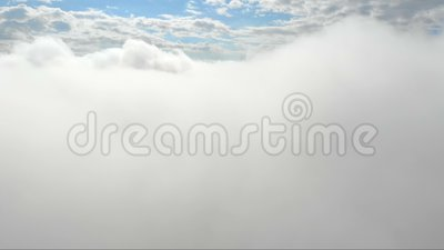 Flying through clouds. Blue sky on the background of a bunch of clouds. Clouds flying, moving heavenly sky video footage.  stock footage