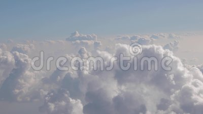 Flying betweeen clouds. Flying between clouds, view from plane window during flight stock video