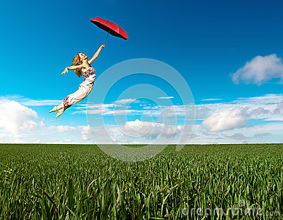 Flying girl with red umbrella