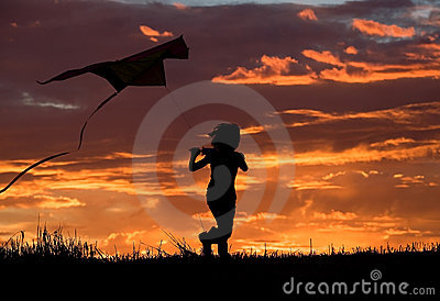 Flying a kite at sunset.