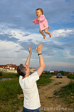 Flying little baby with father Stock Photo