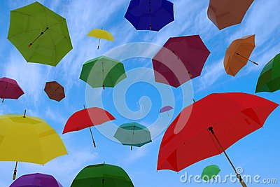 Flying of multicoloured umbrellas