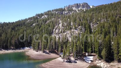 Flying over a mountain lake in California. stock footage