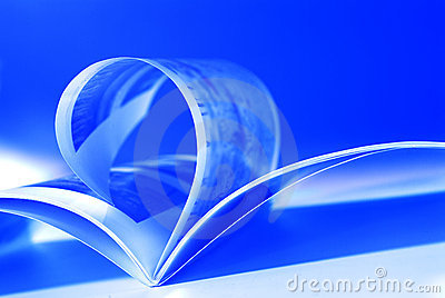 Flying pages on blue