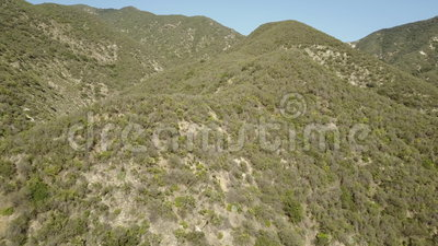 Flying in the Southern California mountains stock footage