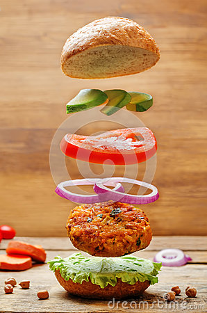 Free Flying Vegan Sweet Potato Chickpea Burgers Stock Photography - 84241112
