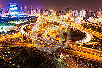 Flyover in modern city at night